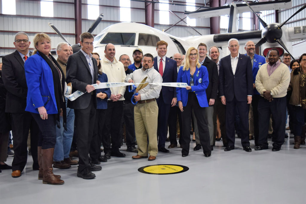 Image shows the ribbon cutting ceremony for the Berry Aviation maintenance hangar grand opening.