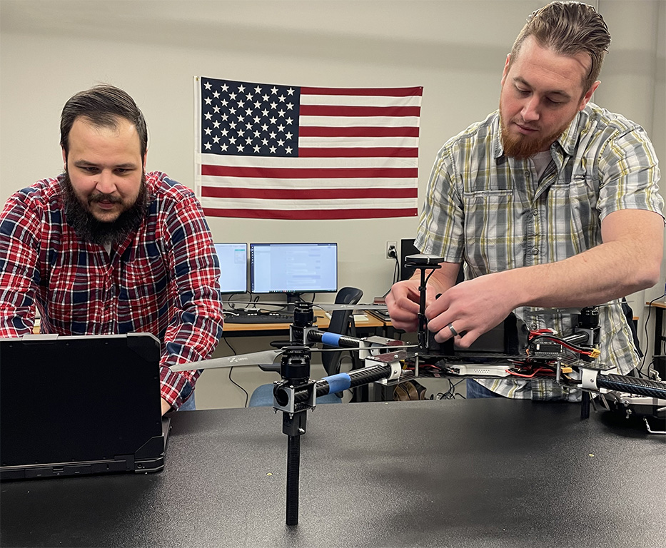 Berry Aviation employees perform final checks on a drone.
